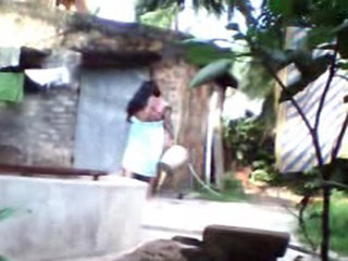 Gallery 185. Desi wife taking shower in open air