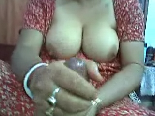 Gallery 300. Aunty showing her considerable natural tits and