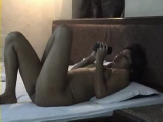 Gallery 336. Indian housewife laying naked on bed while hubby is filming her