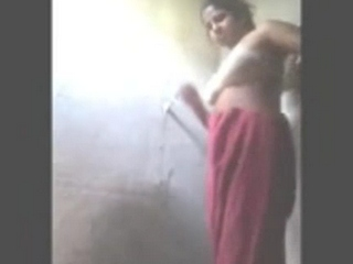 Gallery 915. Indian housewife drying herself after shower