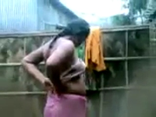 Gallery 932. Indian village girl in open shower recorded